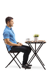 Young man sitting at a coffee table