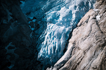 Aerial image of a shining blue glacier in Norway during a sunny day