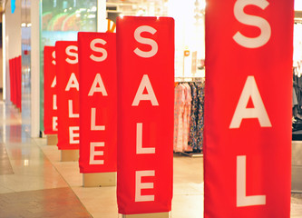 Sale red signs at retail store