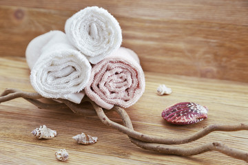 Pile of cotton towels on wooden background with copy space. Selective focus. Spa concept from natural items.