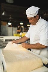 Male baker working in baker shop