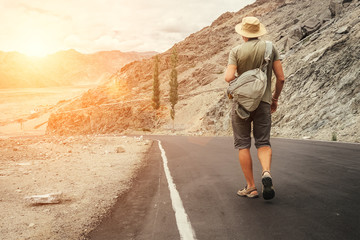 Alone traveler walks on the mountain road in indian Himalaya mountain