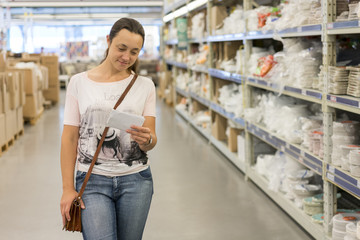 Beautiful woman shopping in supermarket and deciding what to buy. Beautiful woman shopping in supermarket
