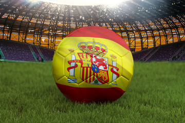 Spain football team ball on big stadium background. Spain Team competition concept. Spain flag on ball team tournament in Russia. Sport competition on green grass background. 3d rendering