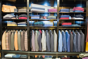 Rows of suit jackets in traditional tailors shop