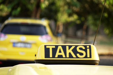 Taxi in Turkey. Taxi car roof sign on bokeh background in Istanbul .