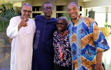 Mauritanian film maker Abderrahmane Sissako, Senegalese musician Youssou N'Dour, Beninese singer Angelique Kidjo and Nigerian musician Femi Kuti pose at a hotel in Lagos