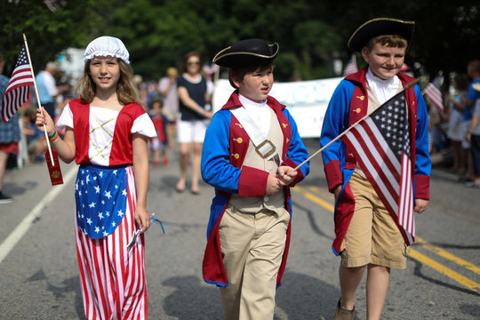Children in costumes march down Main Street during the annual Fourth of July parade in Barnstable Village