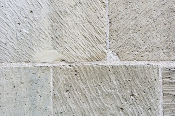 Light Grey grungy stone wall with white gap