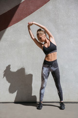 Young woman stretching arms