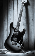 vintage electric guitar on wooden stage