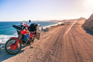 Motorcycle by coastline, Cabo San Lucas, Baja California Sur, Mexico