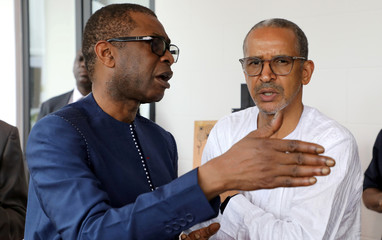 Senegalese musician Youssou N'Dour and Mauritanian film maker Abderrahmane Sissako speak during the inauguration of Alliance Francaise in Lagos