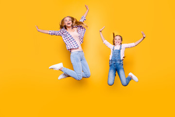 Different teen age game victory win childish emotion expression concept. Full length size body portrait of cheerful laughing delightful comic girl in casual denim outfit isolated on bright background