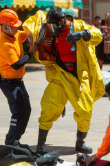 Fireman and hazard protection suit, preparing