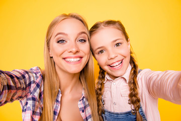 I adore you my best friend! Close up photo portrait of candid careless funky funny pretty sweet laughing cheerful chilling out nice glad ladies taking selfie isolated on bright vivid background