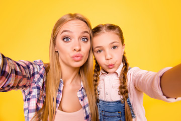 Duck  face! Video stream time mania! Close up portrait of cute beautiful pretty carefree attractive candid joyful sweet lovely cute girls in checkered shirt making selfie isolated bright background
