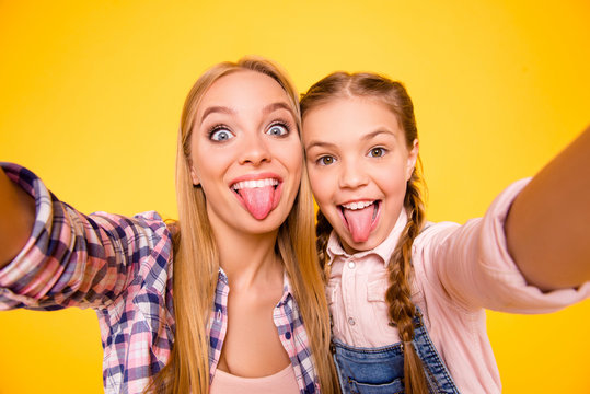 Taking instagram selfie! Close up photo portrait of comic funky rejoicing joking delightful cheerful beautiful with teeth cute carefree girls making photography isolated on bright vivid background