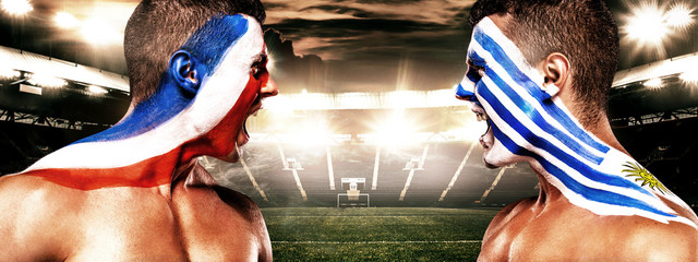 Soccer or football fan with bodyart on face on stadium- flags of Uruguay vs France. Sport Concept with copyspace.