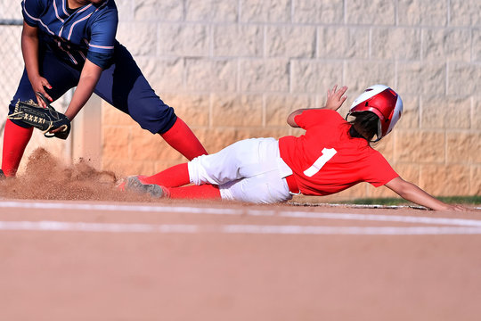 Girl's Softball Player Sliding Into Base