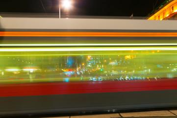Blurry lights city tram at night