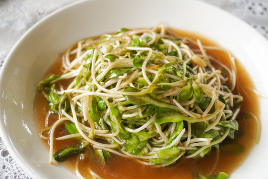 thai traditional stirred fried sunflower sprout with oyster sauce