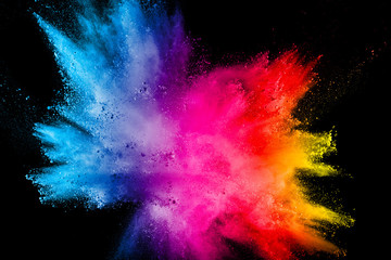 Multi color powder explosion isolated on black background. Wall mural
