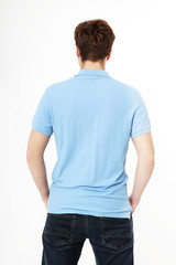 Back view Shirt. Template and blank t shirt. Man in T-Shirt and black jeans isolated on white background.