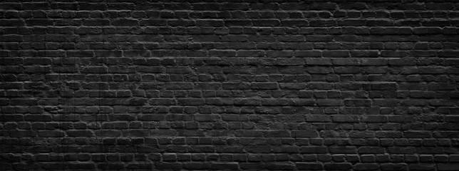 Black brick wall panorama.