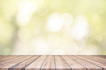 Wood table top and abstract nature blurred bokeh