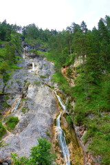 Waterfall with a crystal clear water flowing in Almbach gorge near Berchtesgaden in Eastern Germany, Europe