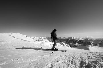Wall Mural - Skier on top of snowy ski slope