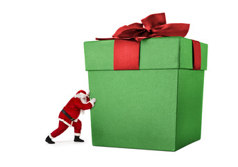 Santa Claus pushing huge gift box full of presents isolated on white background