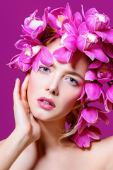 lady in wreath of orchids