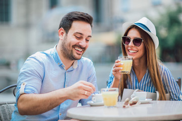 Beautiful loving couple sitting in a cafe enjoying in coffee and conversation