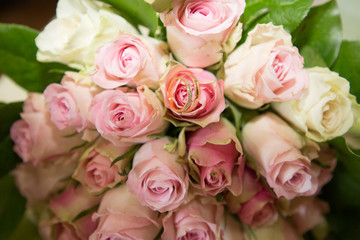 roses wedding bouquet and marriage rings