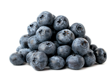 A bunch of ripe blueberries on a white, close-up. Isolated.