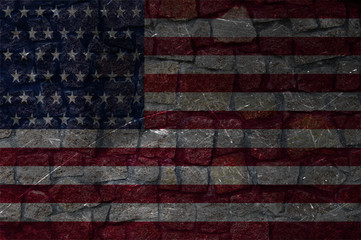 Flag of America on a stone wall