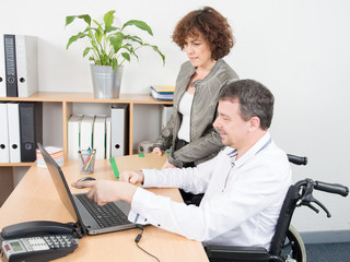 a disabled man office worker in a wheelchair