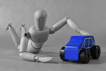 Think of a new car. Advertising concept Photography with guy hugging a toy car. Blue.
