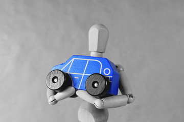 Get a car. Conceptual idea Photography with individual getting a toy car. Blue.