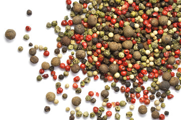 Black, red and white pepper grains isolated on white. Spice. Food.