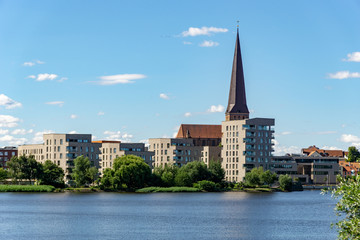 view over the river warnow - skyline of Rostock with Petri church in the background