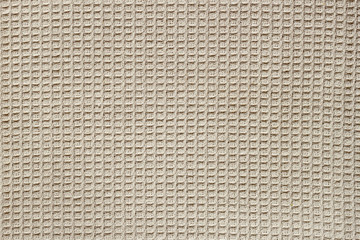 Waffle fabric with visible texture copy space for text, web print design elements. Closeup of light natural cotton texture pattern for backdrop