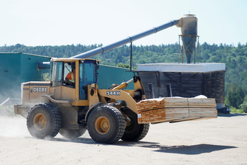 A worker moves lumber at the Murray Brothers Lumber Company in Madawaska