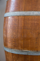 Big Blank Mock Up Aged Plank Wood Barrel for Wine Bier Alcoholic Beverages on Grey Background. Template for Text Product Branding. Vintage Style