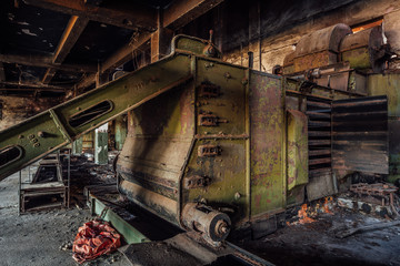 Abandoned tea factory with remnant of rusty equipment