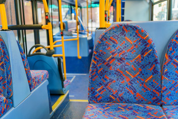 Interior view of a bus with empty seat