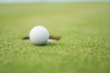 Blerred Close up of golf ball on green