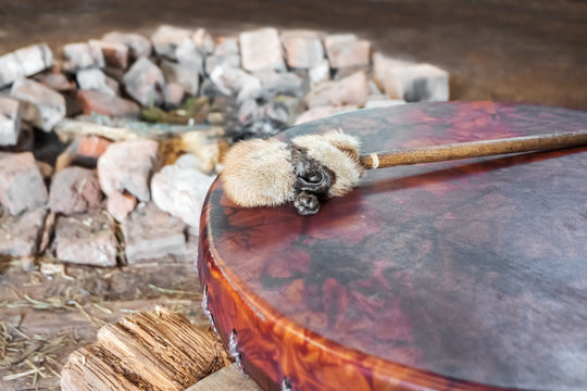 Ancient amerindian tambourine and drum drumstick replica